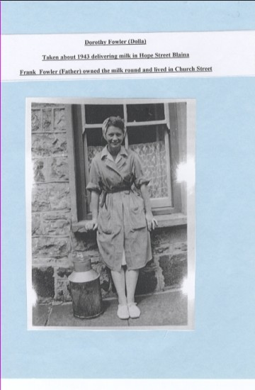 Dorothy (Dolla) Fowler taken c1943 delivering milk in Hope Street, Blaina.  Her father Frank Fowler owned the milk round and lived in Church Street