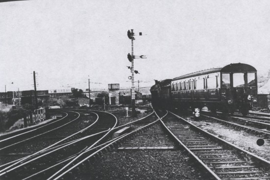 Engine 49148 and coach W15848M at the station