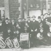 Cwm Town Band outside The Workingmen's Club in Crosscombe Terrace