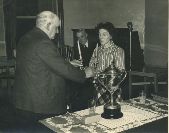 Presentation of a pair of Candlesticks to Mrs.H.Foster by Lewis Baker (Secretary of The Wales Quoiting Association)