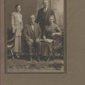 Standing are George Aubrey and his wife Jane (Price).  They lived at Victoria Street at this time, but later lived at the Rectory at West Side.  The couple that are seated are unknown.