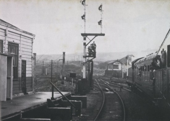An enthusiasts' special posing for photographs at a partially dismantled Abergavenny platform