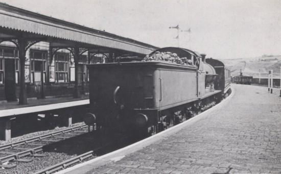 A LNWR 0.8.0 runnig tender first on a Merthyr train
