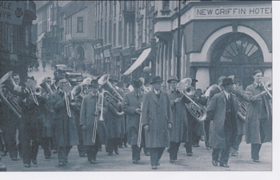 Brynmawr Silver Band playing at the funeral  of the late Mr William (Billy) Rogers marching down BeaufortStreet,Brynmawr