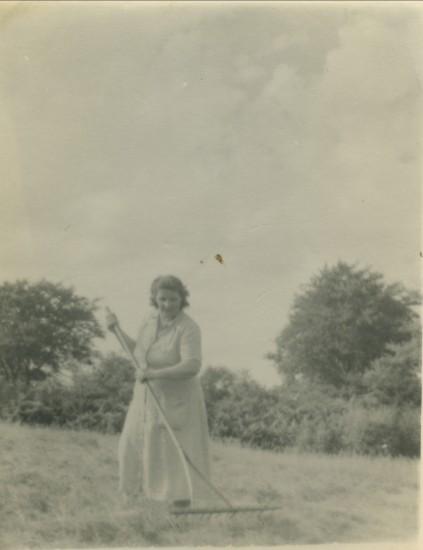 Mrs Irene Mills making hay in Wordl War II