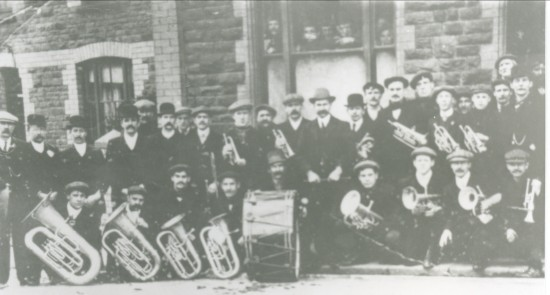 Cwm Town Band outside The Workingmen's Club in Crosscombe Terrace