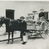 Alan James, Milkman, delivering milk in Augustus Street,Victoria.